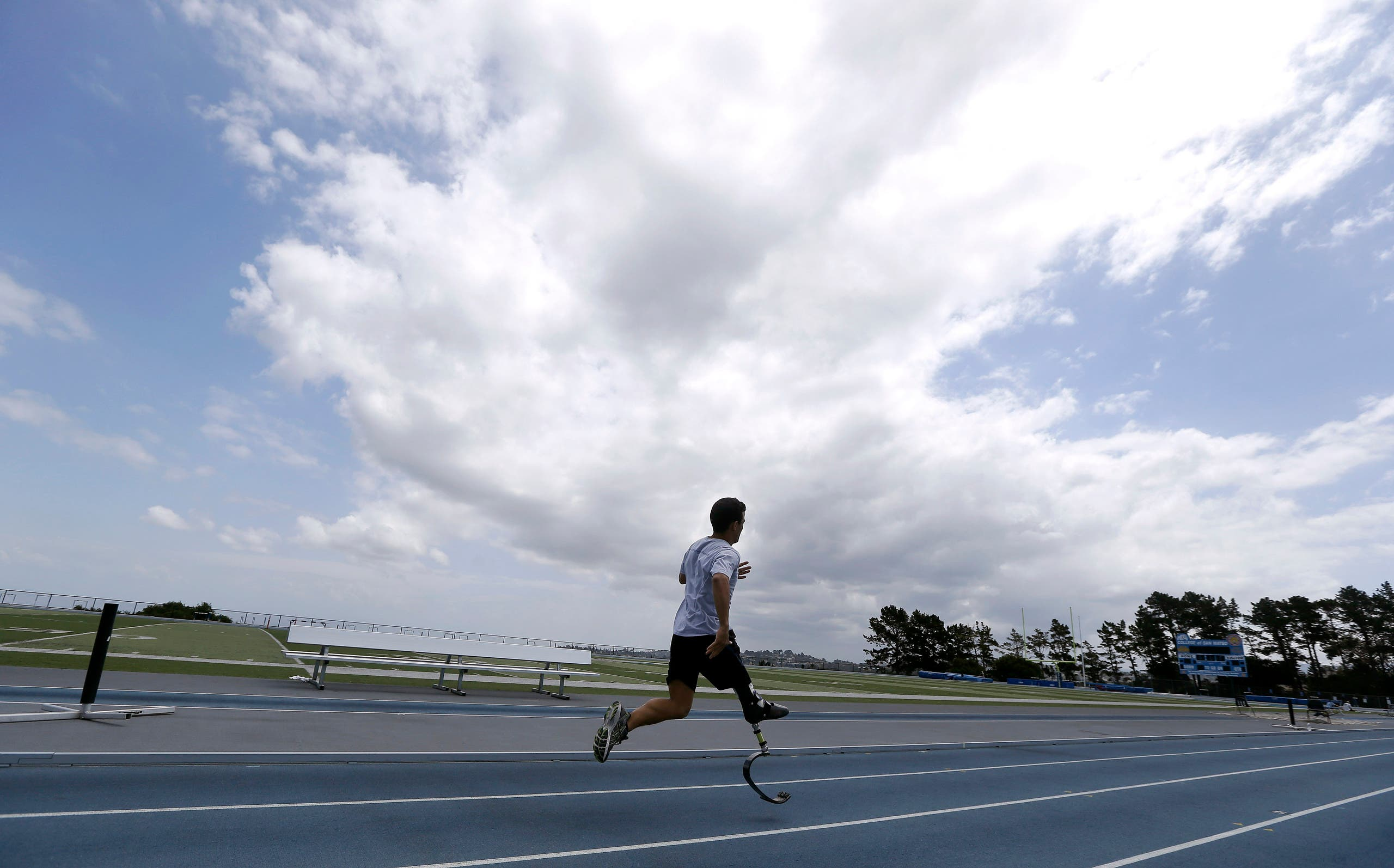 In this May 7, 2013, photo, Mohamed Lahna, a 2016 Paralympic hopeful in the triathlon, poses for a photograph on the College of San Mateo track in San Mateo, Calif. AP