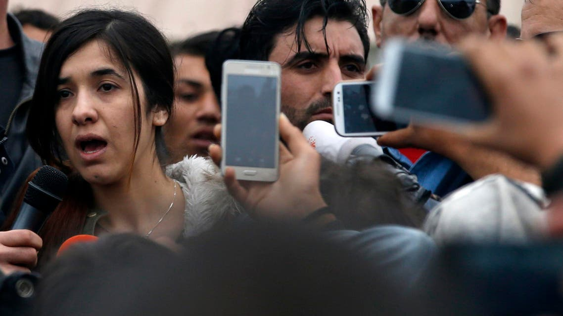An Islamic State  victim Iraqi Yazidi Nadia Murad Basee Taha, left, speaks during her visit in the makeshift refugee camp at the northern Greek border point of Idomeni, Greece, Sunday, April 3, 2016. (AP)