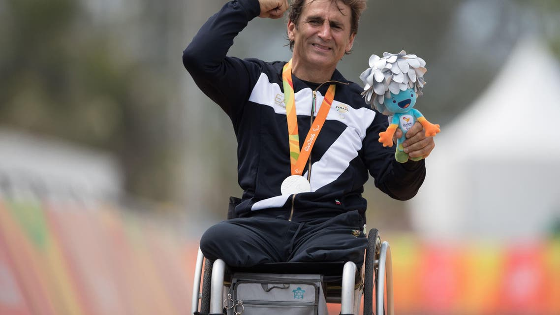 Italy's silver medalist Alessandro Alex Zanardi poses for photos during the medal ceremony for the men's road race H5 hand-cycling event, during the Paralympics Games, in Rio de Janeiro, Brazil, Thursday, Sept. 15, 2016. (AP)