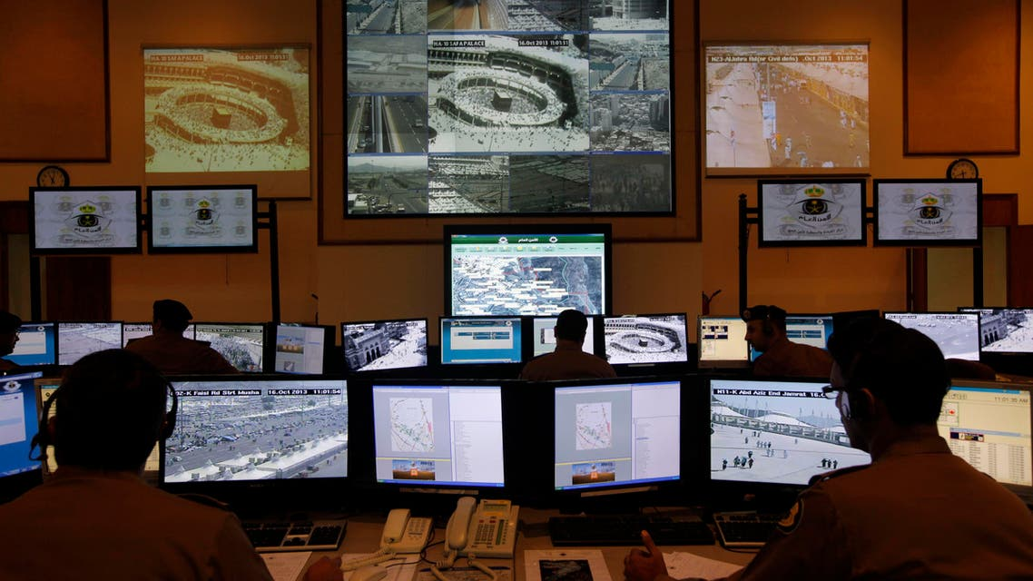 Saudi police officers monitor screens connected to cameras to monitor crowds of pilgrims at holy places in Mina and at the Grand Mosque in Mecca, Saudi Arabia, Wednesday, Oct. 16, 2013. AP