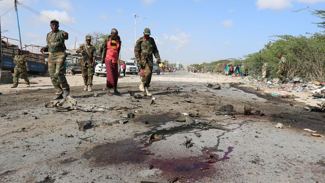 ATTENTION EDITORS - VISUAL COVERAGE OF SCENES OF INJURY OR DEATH ?Somali soldiers inspect the scene of a suicide car bomb attack by al Shabaab in Somalia's capital Mogadishu, September 18, 2016. REUTERS/Feisal Omar