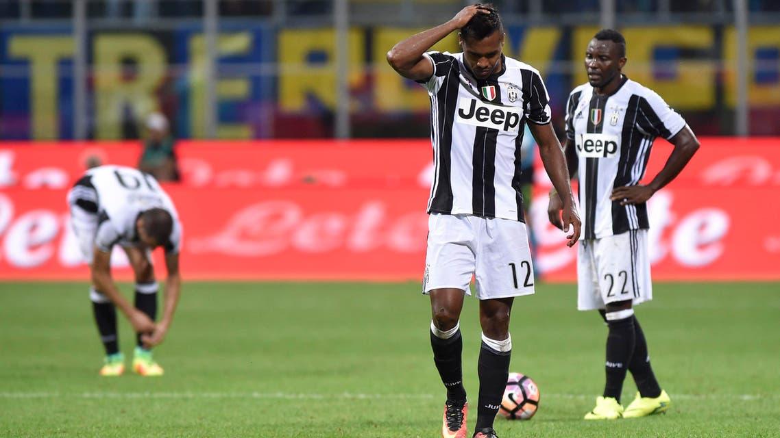 Juventus' Alex Sandro looks dejected Reuters