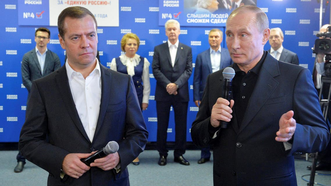 Russian President Vladimir Putin and Prime Minister and Chairman of the United Russia party Dmitry Medvedev visit the party's campaign headquarters following a parliamentary election in Moscow, Russia, September 18, 2016. (Reuters)