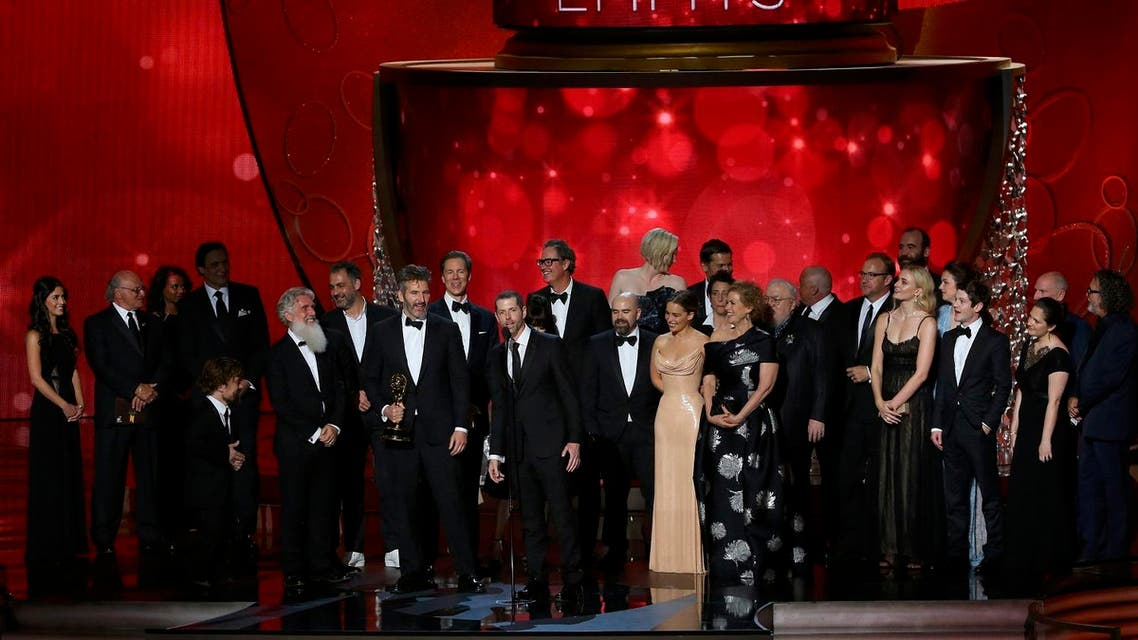 Executive Producers Benioff and Weiss accept the award for Oustanding Drama Series with the cast and crew at the 68th Primetime Emmy Awards in Los Angeles. (Reuters)