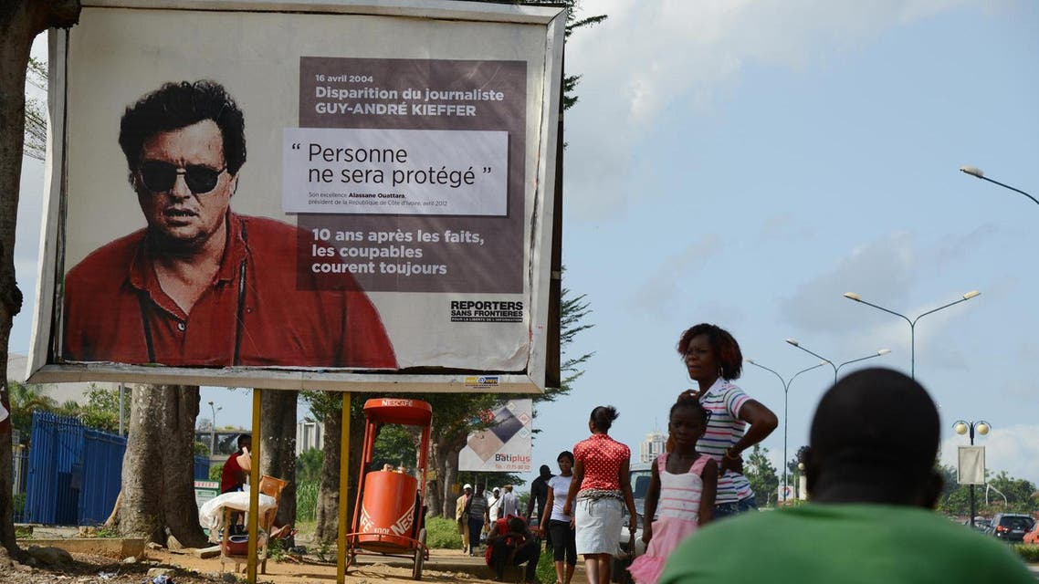 French-Canadian journalist Guy-Andre Kieffer pictured on the billboard was last seen in a car park in Abidjan in April 2004 with Michel Legre (AFP)