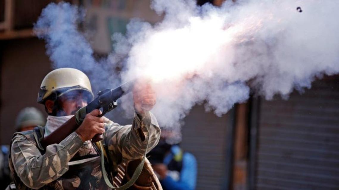 An Indian policeman fires a teargas shell towards demonstrators during a protest against the recent killings in Kashmir. (Reuters)