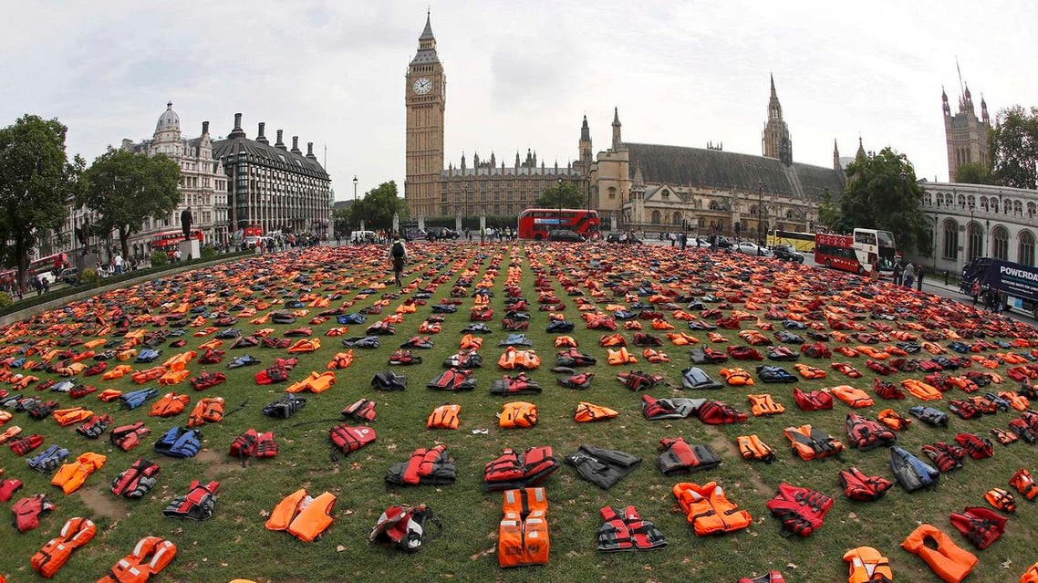 reuters A display of lifejackets worn by refugees during their crossing from Turkey to the Greek island of Chois, are seen Parliament Square in central Londo
