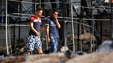 Greek island pleads for refugee evacuations after fire