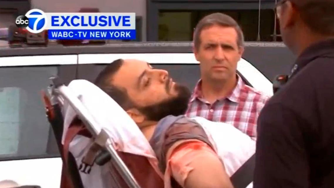 A still image captured from a video from WABC television shows a conscious man believed to be New York bombing suspect Ahmad Khan Rahami being loaded into an ambulance after a shoot-out with police in Linden. (AP)