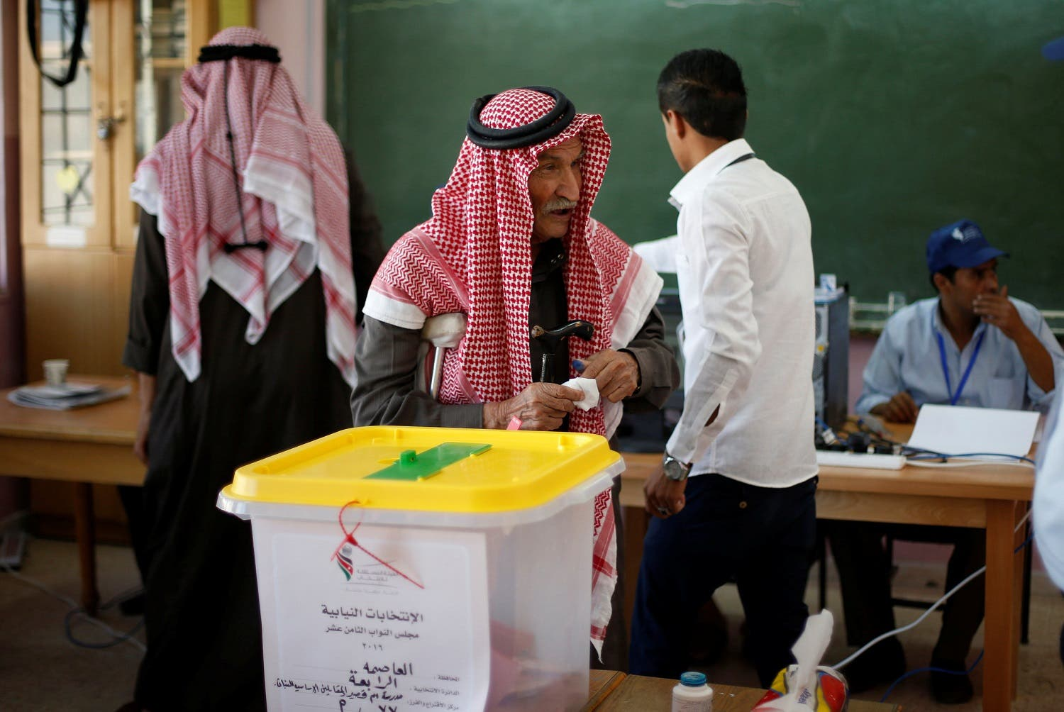 A man casts his ballot at a polling station for parliamentary elections in Amman. (Reuters)