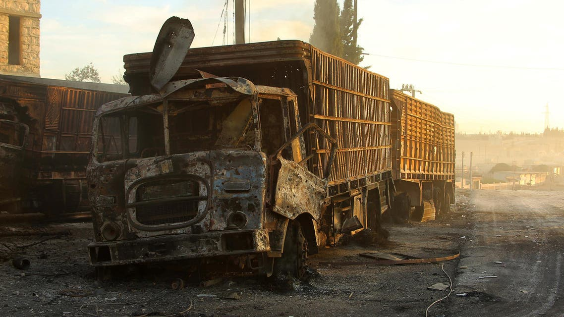 Damaged aid trucks are pictured after an airstrike on the rebel held Urm al-Kubra town. (Reuters)