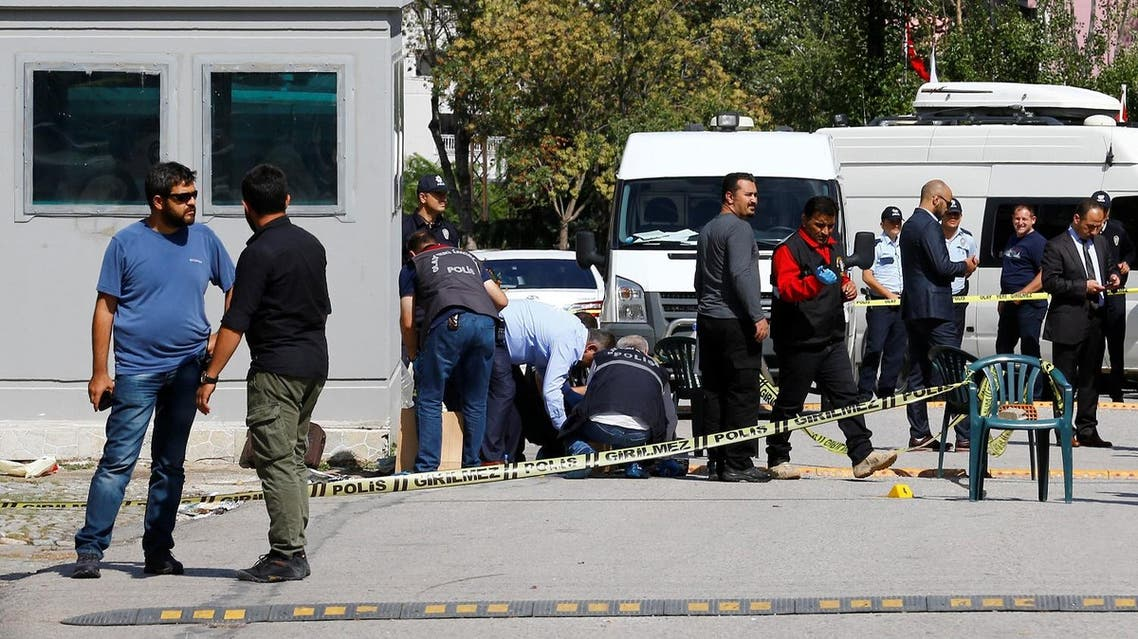 Police forensic experts examine in front of the Israeli Embassy in Ankara. (Reuters)