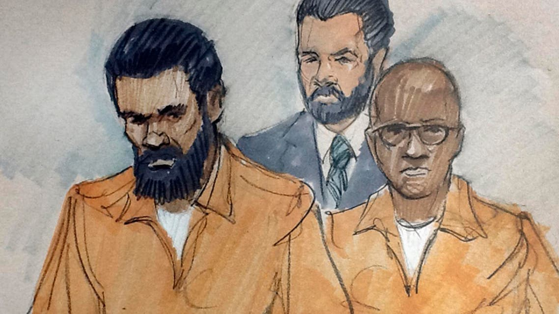 In this March 26, 2015, file courtroom sketch, Jonas Edmonds (left), and his cousin Hasan Edmonds (right), stand in front of an FBI agent as they appear at a hearing at federal court in Chicago following their arrests. (AP)
