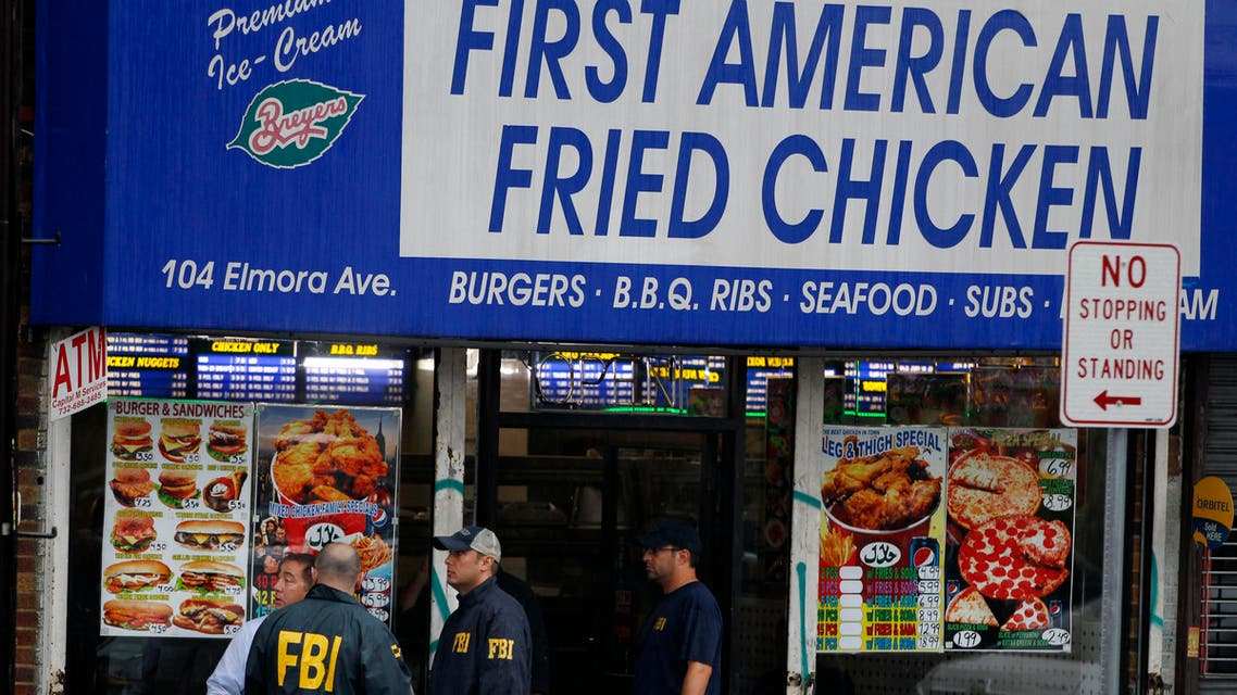 FBI agents walk around during an investigation at a building Monday, Sept. 19, 2016, in Elizabeth, New Jersey, that is tied to Ahmad Khan Rahami, wanted for questioning in the New York City bombing. (AP)