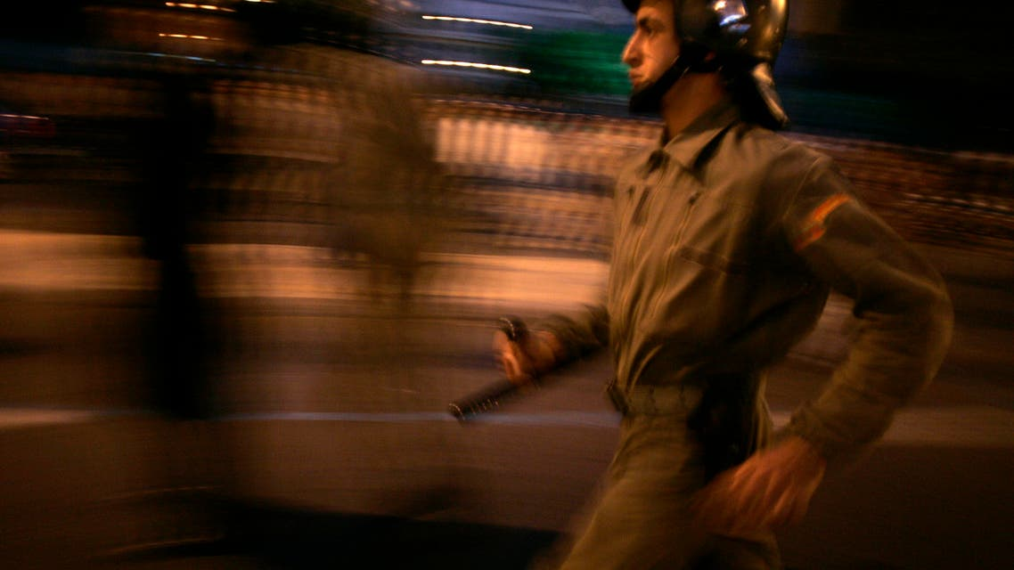 A policeman runs during a protest in Rabat, November 14, 2007. More than 500 people blocked an avenue by chaining themselves together as they demanded for public sector jobs. reuters