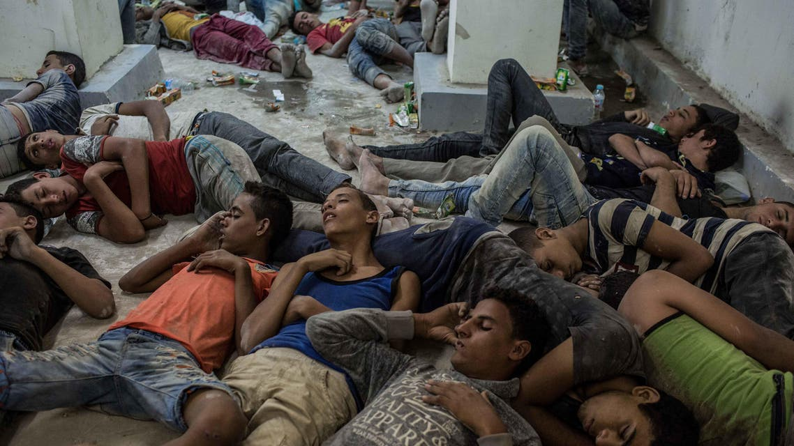 Young Egyptians detained at a police station sleep on the floor in Rosetta, Egypt, after rescued from a boat capsized off the Mediterranean coast near the Egyptian city of Alexandria, Wednesday, Sept. 21, 2016.(AP)
