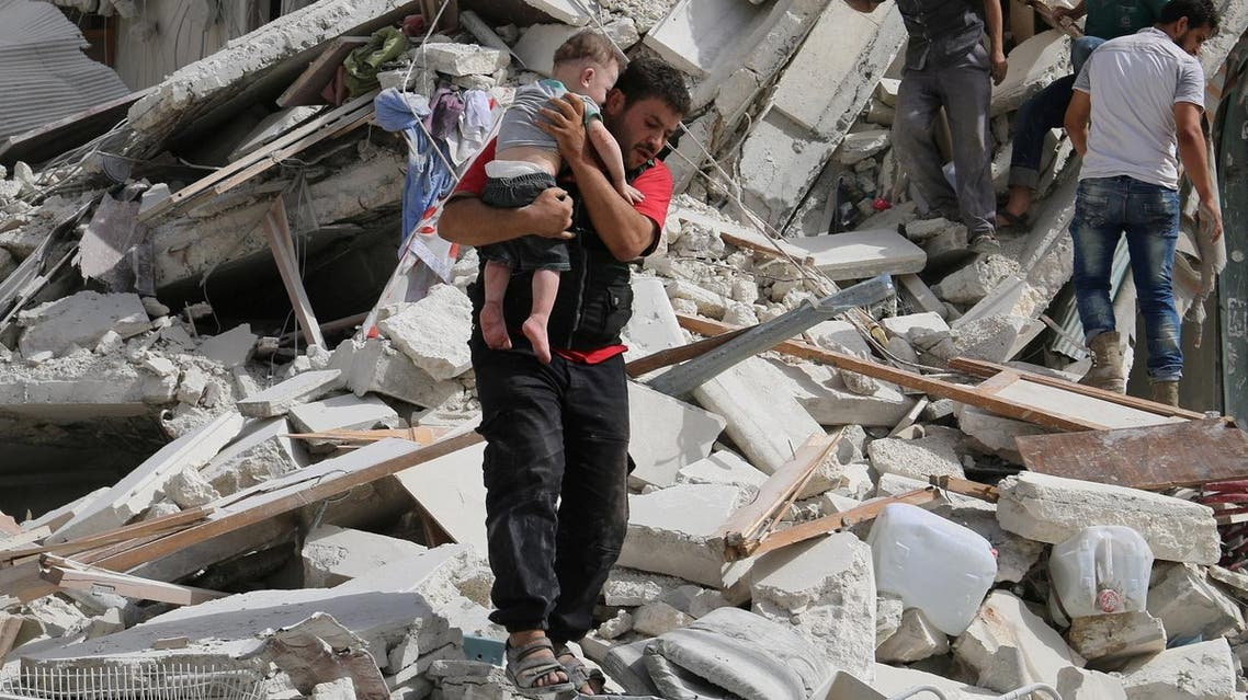 A man carries an injured child after airstrikes on the rebel held al-Qaterji neighbourhood of Aleppo. (Reuters)