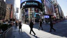 Nasdaq hits record as Fed keeps rates low
