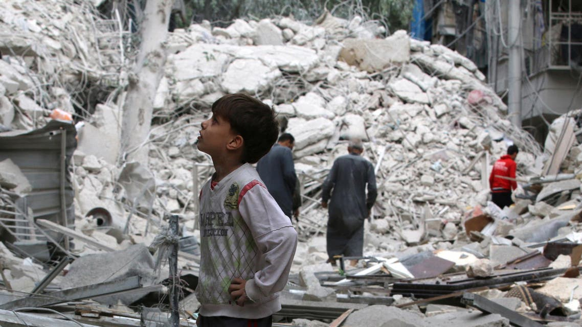 A boy inspects a damaged site after airstrikes on the rebel held Tariq al-Bab neighbourhood of Aleppo, Syria September 23, 2016. REUTERS/Abdalrhman Ismail
