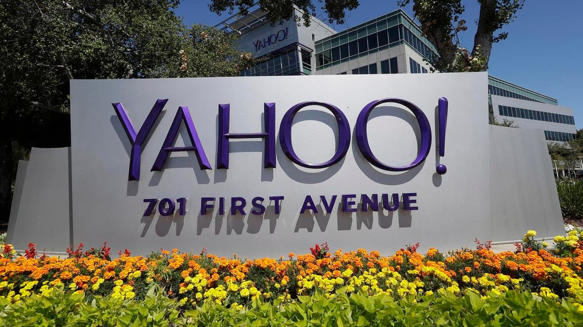 Flowers bloom in front of a Yahoo sign at the company's headquarters (File Photo: AP /Marcio Jose Sanchez)
