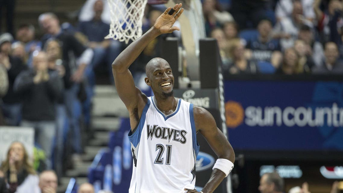 Minnesota Timberwolves forward Kevin Garnett (21) smiles and waves to fans in the second half against the Washington Wizards at Target Center. The Timberwolves won 97-77. Mandatory Credit: Jesse Johnson-USA TODAY Sports