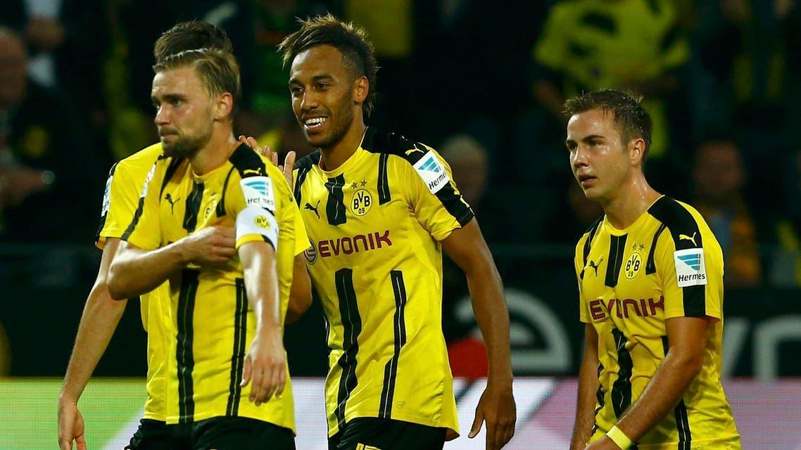 Signal Iduna Park, Dortmund, Germany - 23/09/16 Aubameyang (#17) of Borussia Dortmund celebrates goal against SC Freiburg with team. Reuters