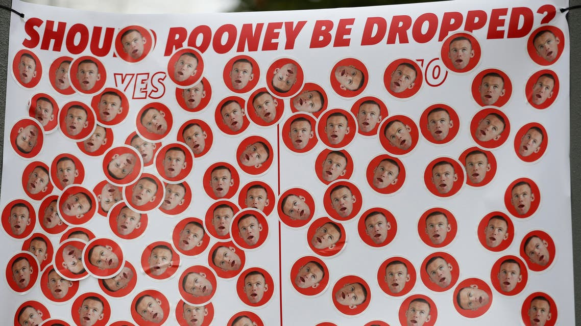 A banner in reference to Manchester United's Wayne Rooney outside the stadium before the match. Reuters