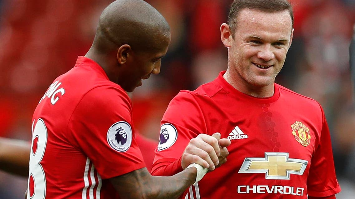 Manchester United's Ashley Young and Wayne Rooney after the match Reuters / Darren Staples