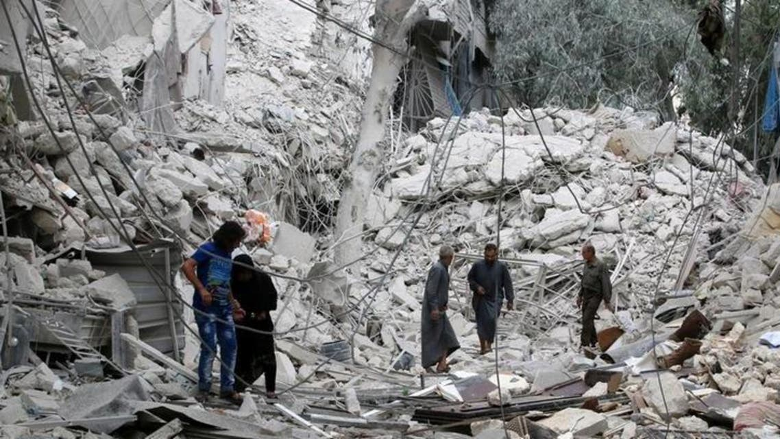 People inspect a damaged site after airstrikes on the rebel held Tariq al-Bab neighbourhood of Aleppo, Syria September 23, 2016. REUTERS/Abdalrhman Ismail