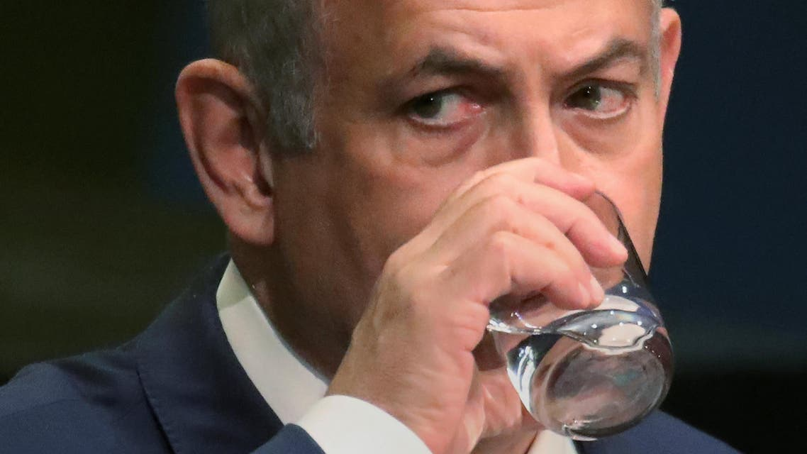 Israel's Prime Minister Benjamin Netanyahu takes a drink of water as he addresses the 71st United Nations General Assembly in the Manhattan borough of New York, U.S., September 22, 2016. REUTERS/Carlo Allegri