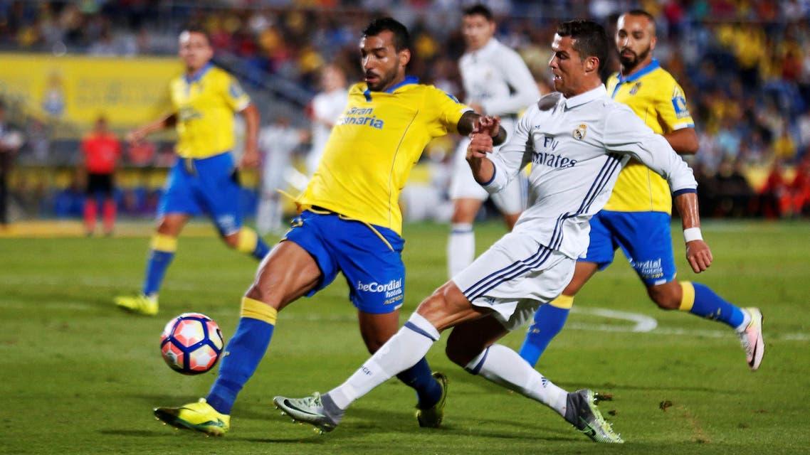 Real Madrid's Cristiano Ronaldo and Las Palmas' Michel Macedo in action. REUTERS