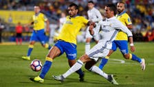 Barcelona close gap as Real draw at Las Palmas