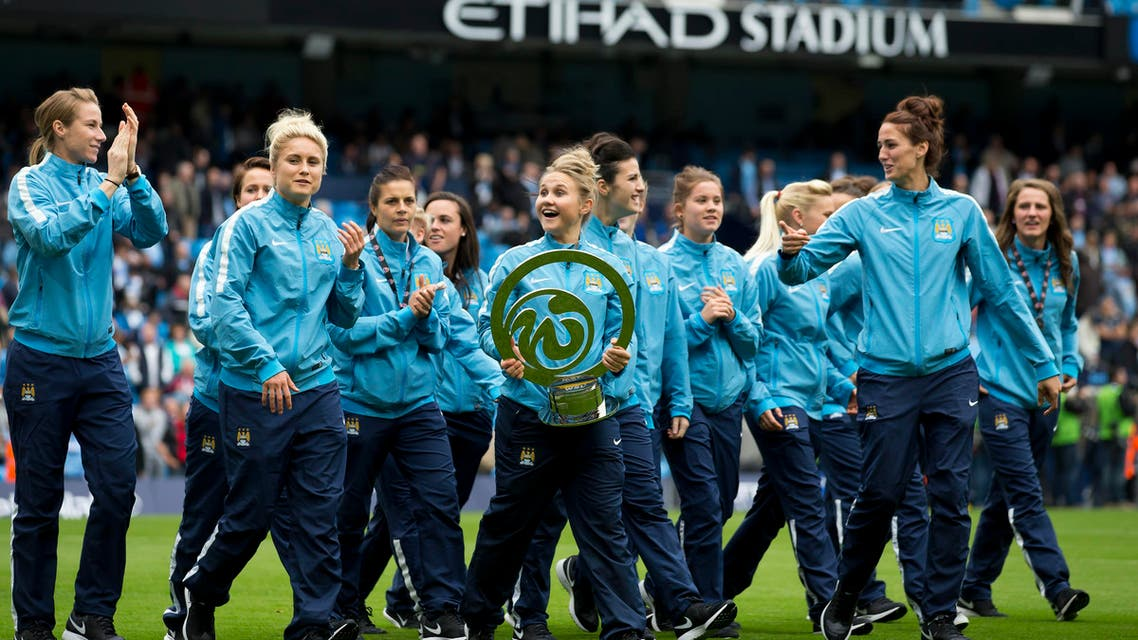 File photo Manchester City Women's football team as parade their recently won Continental Cup trophy on Oct. 18, 2014. (AP Photo)