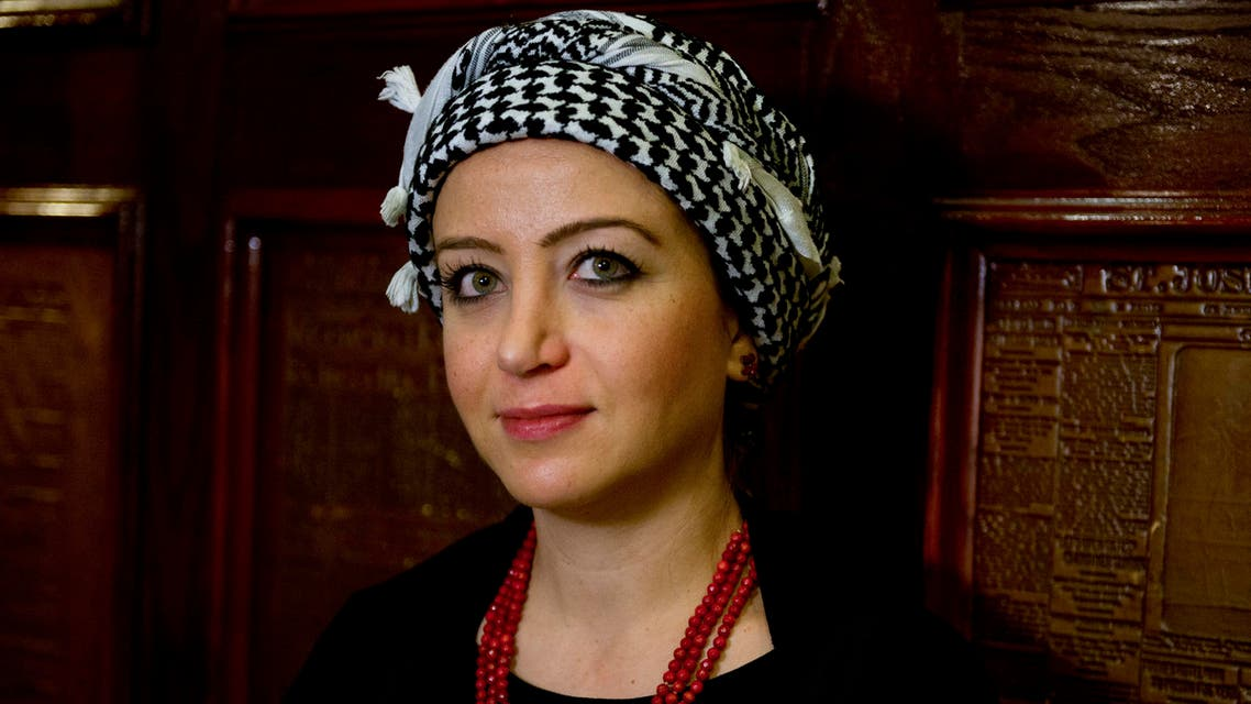 This file photo taken on October 22, 2015 shows Syrian journalist Zaina Erhaim posing for a photo before receiving the 2015 Peter Mackler award at the National Press Club in Washington, DC on October 22, 2015. AFP