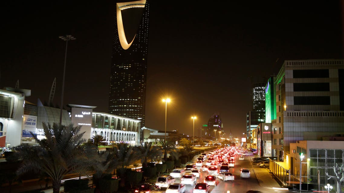 Cars pass by the kingdom tower Sunday, June 14, 2015, in Riyadh, Saudi Arabia. AP