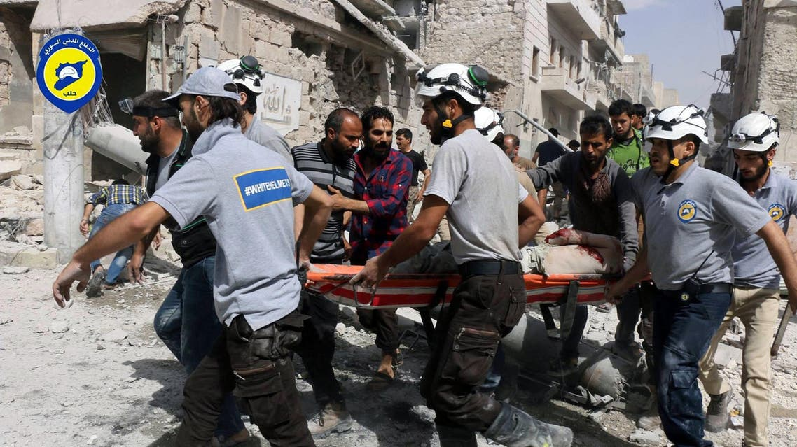 In this Wednesday, Sept. 21, 2016, file photo, provided by the Syrian Civil Defense White Helmets, rescue workers work the site of airstrikes in the al-Sakhour neighborhood of the rebel-held part of eastern Aleppo, Syria. Violence in Aleppo has surged in recent days as a U.S.-Russia-brokered cease-fire collapsed after one week. The Syrian government and its ally Russia have resumed intense airstrikes and Syrian military officials have spoken of a looming ground offensive against rebel-held districts. (Syrian Civil Defense White Helmets via AP)
