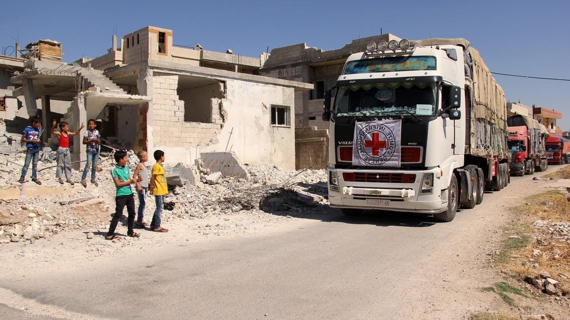 UN had suspended land deliveries after a 31-truck convoy was attacked last Monday at Urem al-Kubra in western Aleppo. (AFP)