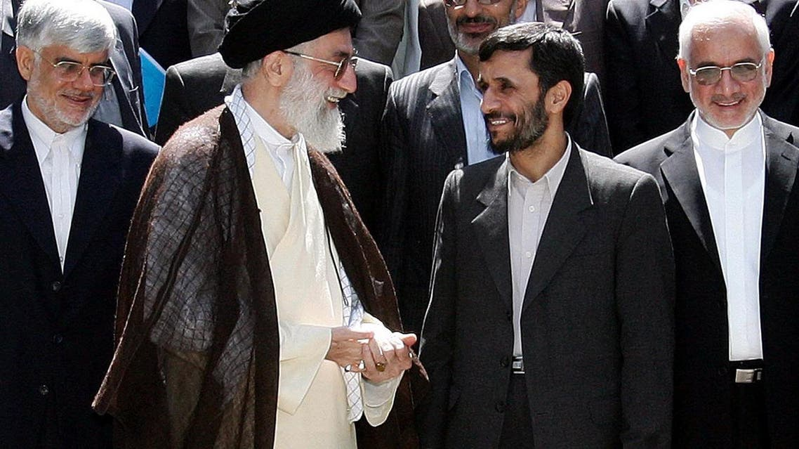 Iranian supreme leader, Ayatollah Ali Khameni, second left, talks with former President Mahmoud Ahmadinejad, second right, when he was still in office (File AP Photo/Amir Kholousi,ISNA)