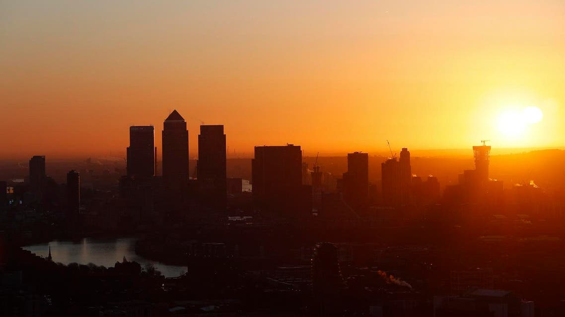 Canary Wharf is seen at sunrise from the Sky Garden of 20 Fenchurch Street, nicknamed the Walkie-Talkie building, in the financial district of the City of London. (Reuters)
