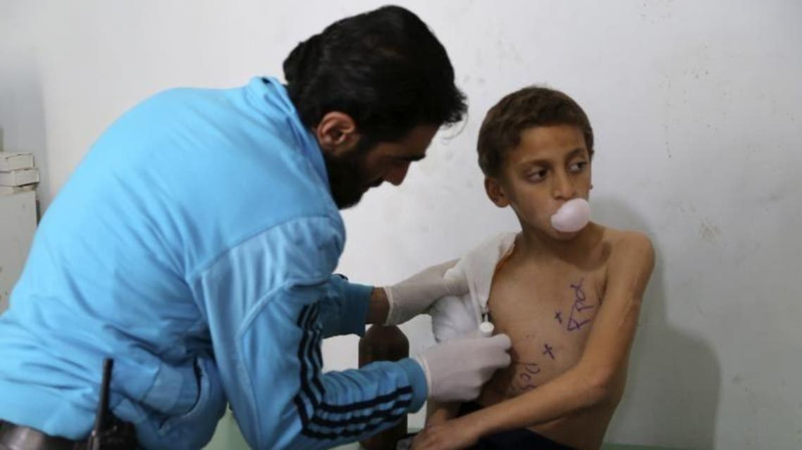 An archived picture shows a doctor treating an injured Syrian child in Aleppo. (Reuters)
