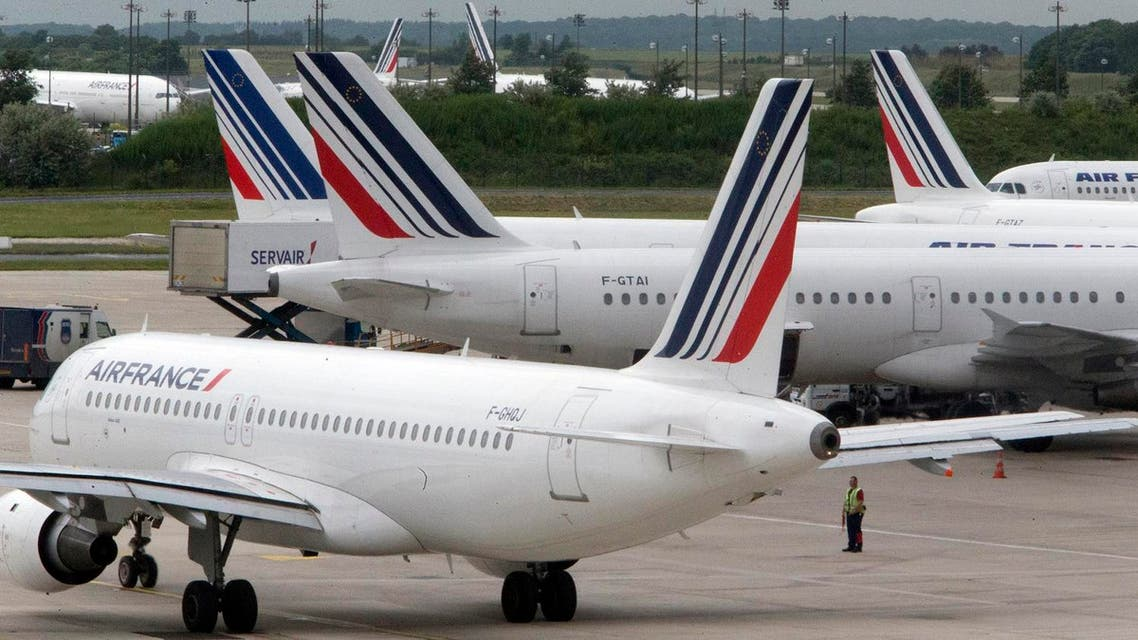 This Thursday, June 13, 2013 file photo shows Air France planes parked on the tarmac at Roissy Charles de Gaulle airport near Paris, France, during an air traffic controllers strike. Air France has cancelled 10 percent of its long-distance flights Friday due to a strike by cabin crew amid mass departures for summer vacation. (AP Photo/Jacques Brinon, File)