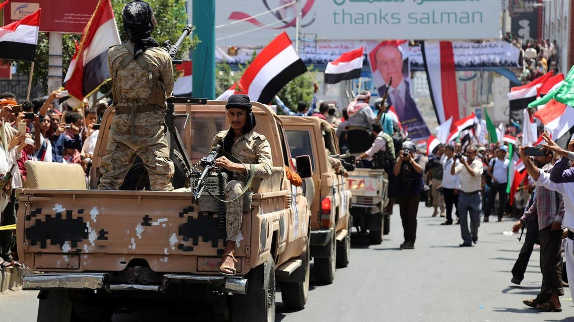 Yemeni pro-government forces, loyal to President Abedrabbo Mansour Hadi, take part in a parade to mark the anniversary of the 1962 revolution. (AFP)