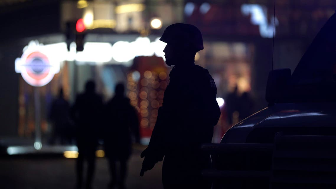 An armed Chinese paramilitary policeman stands watch in the capital city's popular shopping and nightlife area of Sanlitun in Beijing, Tuesday, Dec. 29, 2015. (AP)