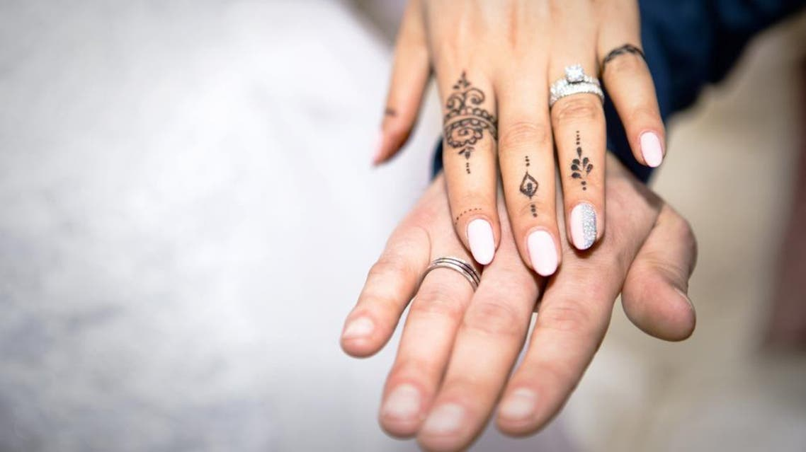 Illustrative image shows the hands of a bride and a groom wearing rings. (Shutterstock)