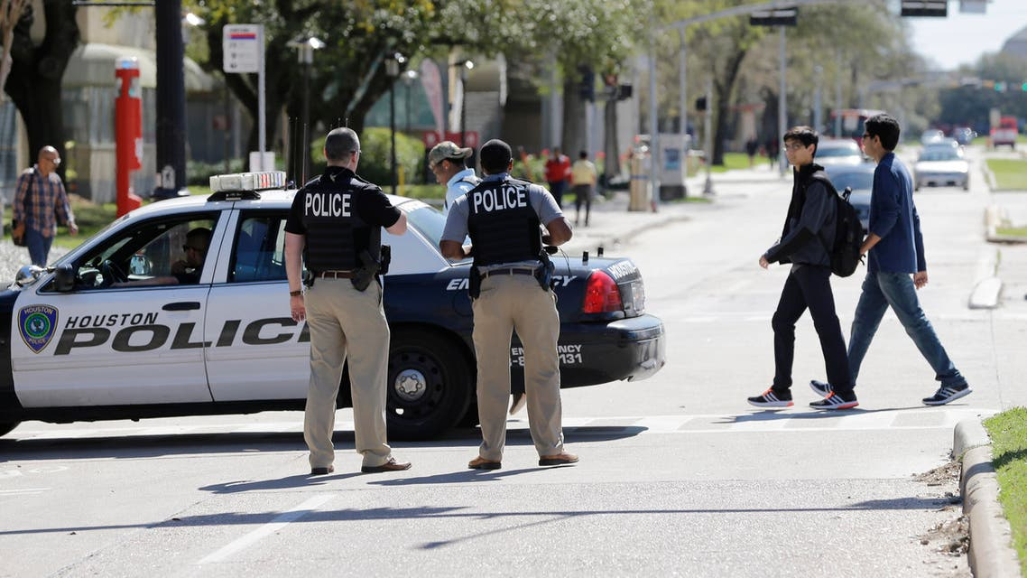 Houston Police secure streets surround The University of Houston before a Republican presidential primary debate, Thursday, Feb. 25, 2016, in Houston. (AP)
