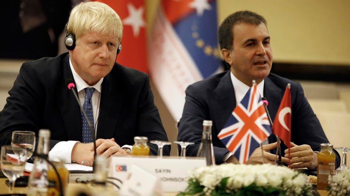 British Foreign Secretary Boris Johnson, left, and Turkey's EU Minister Omer Celik speak to the media before a meeting in Ankara, Turkey, Monday, Sept. 26, 2016 (Photo: AP)
