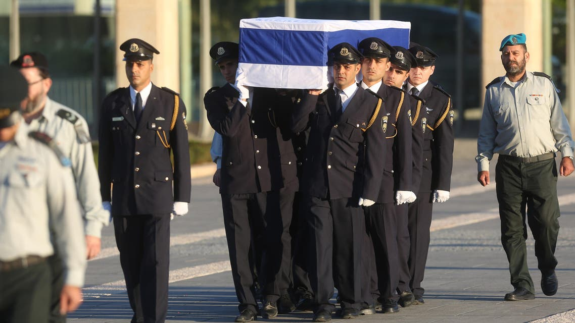Members of the Israeli Knesset guard carry the coffin of former Israeli president Shimon Peres at the Knesset, Israel's Parliament, in Jerusalem on September. 29, 2016. (AFP)