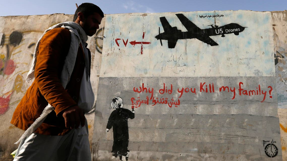 A man walks past a graffiti, denouncing strikes by US drones in Yemen, painted on a wall in Sanaa, Yemen on November 13, 2014. (File photo: Reuters)