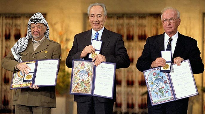 Yitzhak Rabin, Shimon Peres, and Yasser Arafat take a picture the day they receive the 1994 Nobel Peace Prize. (AP)