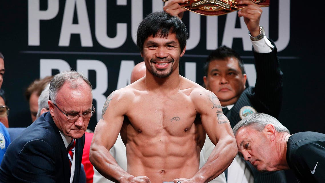 In this April 8, 2016, file photo, Manny Pacquiao, of the Philippines, poses on the scale during a weigh-in in Las Vegas. AP